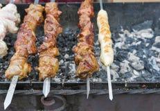 Shish kebab and shashlik on a grill outdoors Royalty Free Stock Photo
