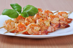 Shish Kebab from Shrimps on dish Stock Images