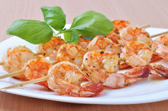 Shish Kebab from Shrimps on dish Royalty Free Stock Image