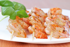 Shish Kebab from Shrimps on dish Stock Photos