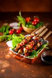Shish kebab. Skewers with marinated ham meat paprika and tomatoes. Selective focus royalty free stock images