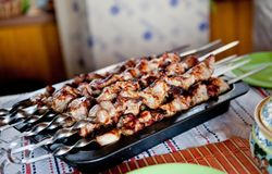 Shish kebab on skewers with onions. royalty free stock photography