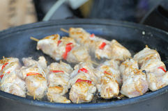 Shish kebab on skewers. Pieces of meat on skewers on the grill Stock Photography