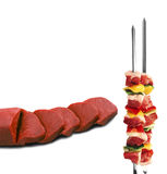 Shish kebab on skewers and raw meat royalty free stock photography