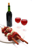 Shish kebab skewers and red wine Stock Photos