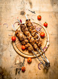 Shish kebab on skewers with tomato. Stock Images