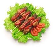 Shish kebab, tomato and green salad on white background. stock photography