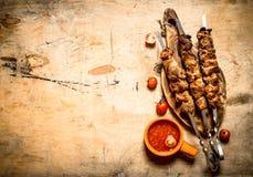 Shish kebab with tomato sauce. Stock Image