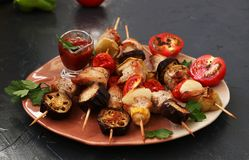 Shish kebab from turkey with vegetables: zucchini, eggplant, onion, tomato and pepper. royalty free stock photography