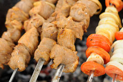 Shish Kebabs Being Cooked on Skewers Royalty Free Stock Photography