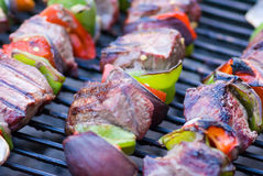 Shish Kebabs on Grill. Shish Kebabs almost ready to eat on grill Stock Images