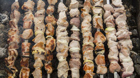 The shish kebabs prepared on a brazier. The pork shish kebabs prepared on a brazier for a holiday royalty free stock photos