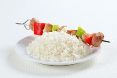 Shish kebabs with rice Stock Images
