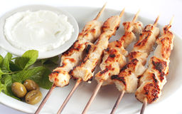 Shish taouk - Chicken shish kebab on white platter. Lebanese and turkish plate Stock Photo