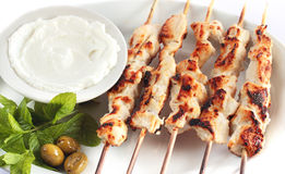 Shish taouk - Chicken shish kebab on white platter. Lebanese and turkish plate Royalty Free Stock Photos