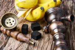 Shisha hookah with banana tobacco flavor royalty free stock photo