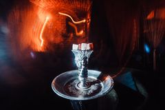Shisha hookah with red hot coals. Sparks from breathe. Modern hookah with coconut charcoal for relax and shisha smoke. Hookah and sparks from coals. close Royalty Free Stock Photo