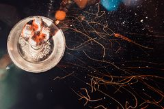 Shisha hookah with red hot coals. Sparks from breathe. Modern hookah with coconut charcoal for relax and shisha smoke. Hookah and sparks from coals Royalty Free Stock Photos