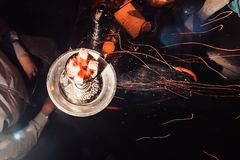 Shisha hookah with red hot coals. Sparks from breathe. Modern hookah with coconut charcoal for relax and shisha smoke. Hookah and sparks from coals. another Stock Image