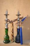 Shisha Pair. Two Arabic Shisha pipes sitting on a sandstone wall stock photography