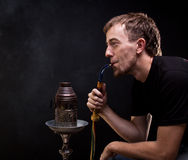 Shisha smoker Stock Photo
