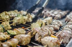 Shishkabob being grilled on a grille Stock Image
