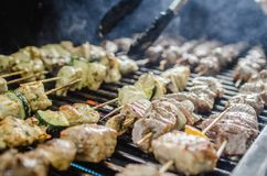 Shishkabob being grilled on a grille Royalty Free Stock Photos