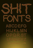 Shit font, letters of shit. Brown color Stock Image