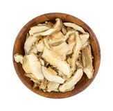 Shitaki Mushrooms Top View. Large sliced dried shitaki mushrooms in wooden bowl ready to reconstitute for your favorite recipes Stock Image