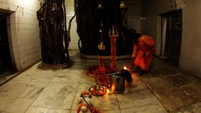 Shiv temple inside Night Aarti Hindu religious ritual of worship performed by young monk