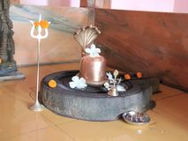 Shiva Linga in a Indian Temple. A religious sculpture of hindu lord shiva Lingam set up on a round stone which is called Yoni, a representation of female stock photography