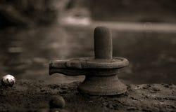 Shiva Linga. An old shiva linga on a river bank Royalty Free Stock Photos