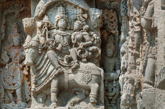 Shiva, Parvati and bull Nandi on wall of Indian temple. Example of ancient architecture, India. Shiva, Parvati and bull Nandi on wall of Indian temple. Example Royalty Free Stock Image