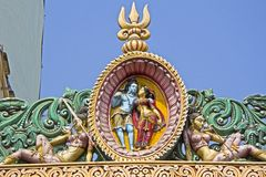 Shiva and Parvati. Image of Shiva and Parvati above the temple gate in Puri Stock Photo