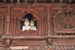 Shiva and Parvati, Kathmandu Durbar Square, Nepal. Image of Shiva and Parvati looking down from a balcony of the Navadurga Temple at UNESCO's World Heritage Site Stock Images