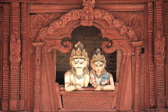 Shiva and Parvati looking down from a balcony. Shiva and Parvati statues,in Durbar Square,Kathmandu,Nepal Royalty Free Stock Image