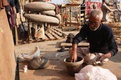 Shiva Ratri Festival. KATHMANDU, NEPAL - JANUARY 2: Preparation to Shiva Ratri Festival, man sculpts a clay bowl in street workshop, January 2, 2009 in Kathmandu Stock Photography