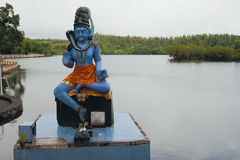 Shiva statue on sacrificial curbstone. Lake Grand Bassin, Mauritius Royalty Free Stock Images