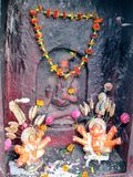 Shiva Street Shrine Varanasi India. Street shrines are everywhere in India. They typically are decorated with flowers and incense. People leave gifts of money Royalty Free Stock Photos