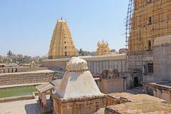 Shiva Virupaksha Temple. Hampi, Karnataka, India. White yellow r. Estored temple against the blue sky. Carving stone royalty free stock image