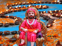 Shivaji Maharaj. An idol of Shivaji Maharaj, the famous maratha(hindu) emperor against the background of many oil-lamps, lit on the occassion of diwali festival Stock Image