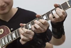 Shivaxe. Triple action on a guitar fretboard royalty free stock images