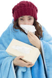 Shivering flu woman sneezing with a tissue Stock Images