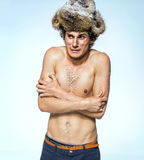 Shivering man frozen, because of bad winter heating Stock Image