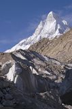Shivling and Gomukh glacier. View to Shivling mountain (6540m high) and edge of Gomukh glacier, where from Bhagirathi river begins and later becomes Ganga Royalty Free Stock Photos