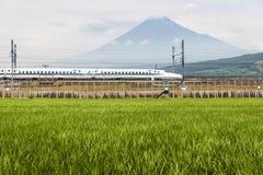 Shinkansen bullet train and Mountain Fuji. Shizuoka - July 03 : Shinkansen bullet train and Mountain Fuji on July 03 , 2017 , Shizuoka ,Japan. Shinkansen is Stock Images