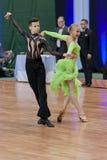 Shkinderov Vladislav och Belisova Polina Perform Youth-2 latin - amerikanskt program på nationell mästerskap Royaltyfri Bild