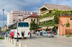 Excursion bus on street Rruga Marin Bicikemi in center of Shkoder, Albania. SHKODER, ALBANIA - SEPTEMBER 6, 2017: Excursion bus on street Rruga Marin Bicikemi in Stock Image