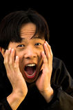 Shock. A young Asian man with a shocked expression on his face royalty free stock photography