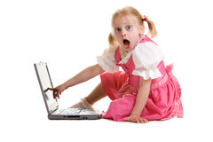 Shock. Young child sitting on computer and finding something shocking Stock Photo